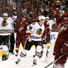 Chicago Blackhawks\' Viktor Stalberg (25), of Sweden, celebrates his goal with teammate Bryan Bickell (29) as Phoenix Coyotes\' Chris Summers (20) and Mikkel Boedker, second from left, of Denmark, show their frustration during the first period in an NHL hockey game Thursday, Feb. 7, 2013, in Glendale, Ariz.(AP Photo/Ross D. Franklin)