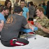 Wearing his British Army uniform, Britain\'s Prince Harry visits with wounded warriors undergoing physical therapy at the Military Advanced Training Center at Walter Reed National Military Medical Center in Bethesda, Md., just outside Washington, Friday, May 10, 2013. (AP Photo/J. Scott Applewhite, Pool)