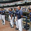 Photo - Milwaukee Brewers Manager Ron Roenicke (10) at his team observes a moment of silence before their baseball game against the St. Louis Cardinals. Saturday, July 12, 2014, in Milwaukee. Brewers shortstop Jean Segura's nine month old son passed away Friday in the Domincan Republic. (AP Photo/Jeffrey Phelps)