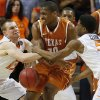 Oklahoma State\'s Phil Forte (13) and Stevie Clark (5) take the ball away from Texas\' Jonathan Holmes (10) during an NCAA college basketball game between the Oklahoma State Cowboys (OSU) and the University of Texas Longhorns at Gallagher-Iba Arena in Stillwater, Okla., Wednesday, Jan. 8, 2014. Oklahoma State won 87-74. Photo by Bryan Terry, The Oklahoman