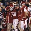 OU\'s Damien Williams (26) is carried off the field with an injury during the college football game between the University of Oklahoma Sooners (OU) and the Notre Dame Fighting Irish at the Gaylord Family-Oklahoma Memorial Stadium on Saturday, Oct. 27, 2012, in Norman, Okla. Photo by Chris Landsberger, The Oklahoman