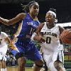 Photo - Baylor guard Odyssey Sims (0), right, drives on San Jose State forward Jasmine Smith (11), left, in the first half of an NCAA college basketball game, Tuesday, Dec. 3, 2013, in Waco, Texas. (AP Photo/Waco Tribune Herald, Natalie Fletcher)