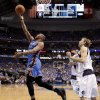 Oklahoma City\'s Russell Westbrook (0) goes past Dallas\' Dirk Nowitzki (41) and Shawn Marion (0) during Game 3 of the first round in the NBA playoffs between the Oklahoma City Thunder and the Dallas Mavericks at American Airlines Center in Dallas, Thursday, May 3, 2012. Oklahoma City won 95-79. Photo by Bryan Terry, The Oklahoman