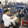 Photo - BIG 12 CHAMPIONSHIP, MERCHANDISE: Hector Maldonado (foreground) and Joey Witt work on the screen printer at USA Screen Printing in Oklahoma City, OK, Thursday, Nov. 29, 2007. By Paul Hellstern / The Oklahoman ORG XMIT: KOD