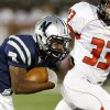 Edmond North\'s Marque Depp runs by Yukon\'s Keegan Meyn during a high school football game at Wantland Stadium in Edmond, Okla., Thursday, October 4, 2012. Photo by Bryan Terry, The Oklahoman