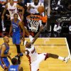 Miami Heat\'s LeBron James, center, shoots past Oklahoma City Thunder\'s Kendrick Perkins (5), Derek Fisher, left, and Russell Westbrook (0) in the first quarter of Game 3 of the NBA Finals basketball series, Sunday, June 17, 2012, in Miami. (AP Photo/The Miami Herald, C.W. Griffin) MAGS OUT ORG XMIT: FLMIH203