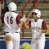 Alabama\'s Kellie Eubanks (16) is congratulated by Brittany Rogers (8) after Eubanks scored in the fifth inning during the softball game in the Women\'s College World Series between Louisiana-Lafayette and Alabama at ASA Hall of Fame Stadium in Oklahoma City, Saturday, May 31, 2008. BY NATE BILLINGS, THE OKLAHOMAN