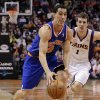 New York Knicks\' Pablo Prigioni (9), of Argentina, drives against Phoenix Suns\' Goran Dragic (1), of Slovenia, during the first half of an NBA basketball game on Wednesday, Dec. 26, 2012, in Phoenix. (AP Photo/Matt York)