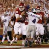 Oklahoma\'s Blake Bell (10) scores a touchdown past Kansas State\'s Arthur Brown (4) during the college football game between the University of Oklahoma Sooners (OU) and the Kansas State University Wildcats (KSU) at the Gaylord Family-Memorial Stadium on Saturday, Sept. 22, 2012, in Norman, Okla. Photo by Chris Landsberger, The Oklahoman