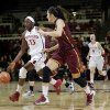 Photo - Stanford forward Chiney Ogwumike (13) dribbles next to Arizona State center Joy Burke during the first half of an NCAA college basketball game Friday, Feb. 14, 2014, in Stanford, Calif. (AP Photo/Marcio Jose Sanchez)
