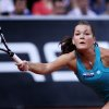 Poland\'s Agnieszka Radwanska hits a forehand against China\'s Li Na during their quarterfinal match at the Porsche tennis Grand Prix in Stuttgart, Germany, Friday, April 27, 2012. (AP Photo/Michael Probst) ORG XMIT: PSTU102