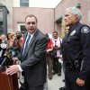 Photo - South Pasadena, Calif., police chief Arthur Miller, right, and South Pasadena Unified School District superintendent Dr. Geoff Yanz announce at a City Hall news conference Tuesday, Aug. 19, 2014, that the police has arrested two South Pasadena High School high school students suspected of planning a massacre at the school after investigators monitored their Internet activities. Miller said that school officials had heard about the plot and informed police, who determined the threat was credible. Police say the boys, ages 16 and 17, didn't have weapons but were researching automatic weapons and explosives, especially propane. (AP Photo/ Nick Ut )