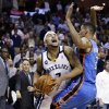 Memphis Grizzlies\' Jerryd Bayless (7) drives to the basket in front of Oklahoma City Thunder\'s Thabo Sefolosha (2), of Switzerland, during the second half of an NBA basketball game in Memphis, Tenn., Wednesday, March 20, 2013. The Grizzlies won 90-89 in overtime. (AP Photo/Danny Johnston)