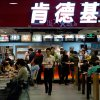 Photo - Customers buy meals at a KFC restaurant at a shopping mall in Beijing Monday, Feb. 25, 2013. KFC launched a campaign Monday to rebuild its battered brand in China, promising tighter quality control after a scandal over misuse of drugs by its poultry suppliers. (AP Photo/Andy Wong)