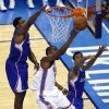 Oklahoma City\'s Kevin Durant (35) shoots a lay up in between Los Angeles\' DeAndre Jordan (6) and Matt Barnes (22) during Game 2 of the Western Conference semifinals in the NBA playoffs between the Oklahoma City Thunder and the Los Angeles Clippers at Chesapeake Energy Arena in Oklahoma City, Wednesday, May 7, 2014. Photo by Sarah Phipps, The Oklahoman