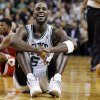 Photo - Boston Celtics forward Kevin Garnett (5) reacts on the court after a floor scramble with Chicago Bulls forward Jimmy Butler (21) during the fourth quarter of an NBA basketball game in Boston, Wednesday, Feb. 13, 2013. The Celtics gained possession of the ball and went on to win 71-69. (AP Photo/Elise Amendola)