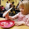 Kindergarten student Emma Telukevich, 5, decorates a cookie during her class Valentine\'s Day party at Chisholm Elementary School in Edmond, OK, Friday, Feb. 13, 2009. BY PAUL HELLSTERN, THE OKLAHOMAN