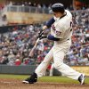 Minnesota Twins\' Justin Morneau (33) hits a solo home run against New York Mets starting pitcher Matt Harvey during the seventh inning of a baseball game Saturday, April 13, 2013, in Minneapolis. The Mets won 4-2. (AP Photo/Genevieve Ross)