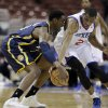 Photo - Philadelphia 76ers' Thaddeus Young, right, steals the ball from Indiana Pacers' Ian Mahinmi during the first half of an NBA basketball game on Saturday, March 16, 2013, in Philadelphia. (AP Photo/Matt Slocum)
