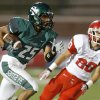 Edmond Santa Fe\'s Dale Jefferson runs past Lawton\'s Casey Nadeau during their high school football game at Wantland Stadium in Edmond, Okla., Thursday, October 11, 2012. Photo by Bryan Terry, The Oklahoman