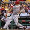 Photo - Cincinnati Reds' Billy Hamilton drives in two runs with a double off Pittsburgh Pirates relief pitcher Stolmy Pimentel during the third inning of a baseball game in Pittsburgh Wednesday, June 18, 2014. (AP Photo/Gene J. Puskar)