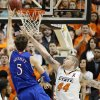 Oklahoma State \'s Philip Jurick (44) defends on Kansas\' Jeff Withey (5) during the college basketball game between the Oklahoma State University Cowboys (OSU) and the University of Kanas Jayhawks (KU) at Gallagher-Iba Arena on Wednesday, Feb. 20, 2013, in Stillwater, Okla. Photo by Chris Landsberger, The Oklahoman
