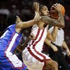 Oklahoma\'s Cameron Clark (21) keeps the ball away from Louisiana Tech\'s Raheem Appleby (3) during a men\'s college basketball game between the University of Oklahoma Sooners (OU) and the Louisiana Tech Bulldogs at Lloyd Noble Center in Norman, Okla., Monday, Dec. 30, 2013. Photo by Nate Billings, The Oklahoman