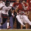 Oklahoma\'s Kenny Stills (4) scores a touchdown in front of Texas Tech\'s Tre\' Porter (5) during the college football game between the University of Oklahoma Sooners (OU) and Texas Tech University Red Raiders (TTU) at the Gaylord Family-Oklahoma Memorial Stadium on Saturday, Oct. 22, 2011. in Norman, Okla. Photo by Chris Landsberger, The Oklahoman