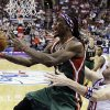 Milwaukee Bucks\' Marquis Daniels, left, goes up for a shot as Philadelphia 76ers\' Spencer Hawes defends in the first half of an NBA basketball game, Monday, Nov. 12, 2012, in Philadelphia. (AP Photo/Matt Slocum)