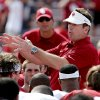 Head coach Bob Stoops talks to his team following the Spring College Football Game of the University of Oklahoma Sooners (OU) at Gaylord Family-Oklahoma Memorial Stadium in Norman, Okla., on Saturday, April 12, 2014. Photo by Steve Sisney, The Oklahoman