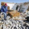 Rick Smith, warning coordination meteorologist, and Mike Foster, meteorologist in charge, both with the National Weather Service Forecast Office, Norman, looking at house damage to rate the tornado intensity on Brock Road in Lone Grove, Wednesday, Feb. 11, 2009. BY PAUL B. SOUTHERLAND, THE OKLAHOMAN