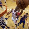 Photo - Houston Rockets center Dwight Howard (12) lays the ball up during the first quarter of an NBA basketball game against the New York Knicks, Friday, Jan. 3, 2014, in Houston. (AP Photo/Patric Schneider)