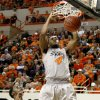 Oklahoma State\'s Brian Williams (4) dunks the ball beside Kansas State\'s Jamar Samuels (32) during an NCAA college basketball game between the Oklahoma State University Cowboys (OSU) and the Kansas State University Wildcats (KSU) at Gallagher-Iba Arena in Stillwater, Okla., Saturday, Jan. 21, 2012. Photo by Bryan Terry, The Oklahoman