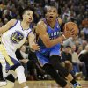 Oklahoma City Thunder\'s Russell Westbrook, right, drives past Golden State Warriors\' Stephen Curry (30) during the first half of an NBA basketball game, Wednesday, Jan. 22, 2013, in Oakland, Calif. (AP Photo/Ben Margot) ORG XMIT: OAS101