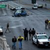 Law enforcement personal investigate a mulit-vehicle accident on Las Vegas Blvd and Flamingo Road, Thursday, Feb. 21, 2013. Authorities say a Range Rover opened fire on a Maserati at a stoplight, sending it crashing into a taxi that went up in flames, leaving three people dead and at least six injured. Police were checking with nearby businesses to see whether a previous altercation prompted the car-to-car attack (AP Photo/Las Vegas Review-Journal, Jeff Scheid) LOCAL TV OUT; LOCAL INTERNET OUT; LAS VEGAS SUN OUT