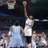 Oklahoma City\'s Kendrick Perkins (5) puts up a shot in front of Denver\'s Nene (31) during the first round NBA playoff game between the Oklahoma City Thunder and the Denver Nuggets on Sunday, April 17, 2011, in Oklahoma City, Okla. Photo by Chris Landsberger, The Oklahoman