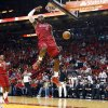 Miami Heat\'s LeBron James (6) dunks as Oklahoma City Thunder\'s Russell Westbrook (0) and Heat\'s Mario Chalmers (15) watch during the first half of an NBA basketball game, Tuesday, Dec. 25, 2012, in Miami. (AP Photo/J Pat Carter) ORG XMIT: FLJC101