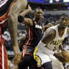 Indiana Pacers\' Roy Hibbert (55) goes to the basket against Miami Heat\'s Chris Bosh (1) during the second half of Game 3 of the NBA Eastern Conference basketball finals in Indianapolis, Sunday, May 26, 2013. (AP Photo/Nam H. Huh)