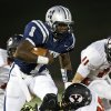 Edmond North\'s Michael Farmer tries to leap past Yukon\'s Zayne Nave during their high school football game at Wantland Stadium in Edmond, Okla., Thursday, October 4, 2012. Photo by Bryan Terry, The Oklahoman