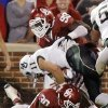 Baylor\'s Nick Florence (11) gets by Oklahoma\'s Javon Harris (30) and Chuka Ndulue (98) for a two point conversion during the college football game between the University of Oklahoma Sooners (OU) and Baylor University Bears (BU) at Gaylord Family - Oklahoma Memorial Stadium on Saturday, Nov. 10, 2012, in Norman, Okla. Photo by Chris Landsberger, The Oklahoman