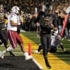 Photo - Missouri's Marcus Murphy, right, scores a touchdown in front of South Carolina's T.J. Holloman, center, and Missouri's Justin Britt (68) during the first quarter of an NCAA college football game Saturday, Oct. 26, 2013, in Columbia, Mo. (AP Photo/L.G. Patterson)