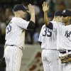 New York Yankees\' Zoilo Almonte, right, celebrates with teammate Lyle Overbay (55) after a baseball game against the Tampa Bay Rays, Friday, June 21, 2013, in New York. The Yankees won the game 6-2. (AP Photo/Frank Franklin II)