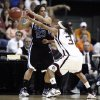 NCAA TOURNAMENT, WOMEN\'S COLLEGE BASKETBALL: Texas A&M University player Takia Straks knocks the ball loose from Duke player Wanisha Smith during the regional semifinals of the NCAA women\'s basketball tournament between Duke and Texas A&M at the Ford Center in Oklahoma City, Okla., on Sunday, March 30, 2008. BY SARAH PHIPPS, THE OKLAHOMAN