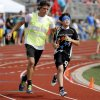 Gianni Toce runs beside his guide Joseph Brown before the start of a race during the UCO Endeavor Games at the Edmond North High School School track, Saturday, June 7, 2014. Photo by Bryan Terry, The Oklahoman