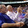 Photo - Former Texas Rangers president Nolan Ryan, right, shared the front row with former President George W. Bush as Ryan made his return, with his new team the Houston Astros, at the Globe Life Park in Arlington, TX on Friday, April 11, 2014.(AP Photo/The Dallas Morning News, Tom Fox)