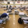 An evacuee sleeps on a cot at a temporary American Red Cross shelter at the Robert Ellis Young Gymnasium at Missouri Southern State University in Joplin, Mo., Monday, May 23, 2011. About 100 people stayed at the shelter overnight after a destructive tornado moved through the city on Sunday evening, killing at least 89 people and injuring hundreds more. (AP Photo/Mark Schiefelbein) ORG XMIT: MOMS102