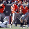 Oklahoma State\'s Cooper Bassett (80) and Caleb Lavey (45) celebrate a sack on Baylor\'s Robert Griffin III (10) during a college football game between the Oklahoma State University Cowboys (OSU) and the Baylor University Bears (BU) at Boone Pickens Stadium in Stillwater, Okla., Saturday, Oct. 29, 2011. Photo by Sarah Phipps, The Oklahoman
