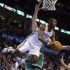 Oklahoma City\'s Reggie Jackson (15) flies through the air after colliding with Boston\'s Kris Humphries (43) during the NBA game between the Oklahoma City Thunder and the Boston Celtics at the Chesapeake Energy Arena., Sunday, Jan. 5, 2014. Photo by Sarah Phipps, The Oklahoman