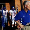 Moore coach Scott Myers waits with his team to take the field against Westmoore during their high school football game at Moore Stadium in Moore, Oklahoma on Friday, September 2, 2011. Photo by John Clanton, The Oklahoman