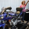 Denise Dickenson stands by her Yamaha FZ1 at Maxey\'s Cycles in Oklahoma CIty, Saturday, March 24, 2012. Maxey\'s Cycles hosted a party in honor of Denise Dickenson after she recently passed the 200,000 mile mark on her Yamaha FZ1. Photo by Bryan Terry, The Oklahoman